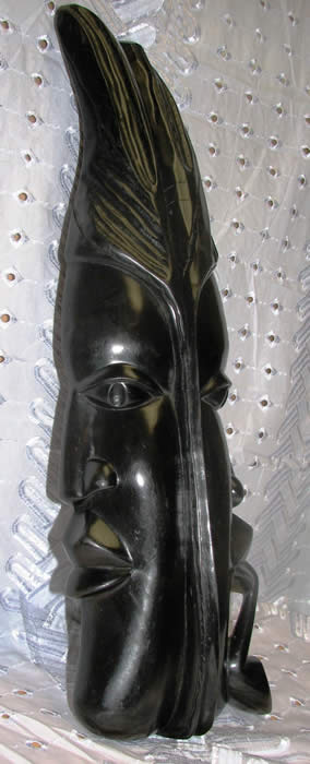 African masks - saint and sinner, african art, wood carvings - left view
